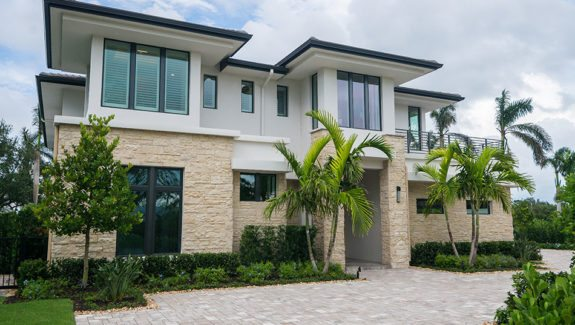 Contemporary 2-story house plan features 4 bedrooms, 5 baths, 1 half bath, 3 car garage, great room, island kitchen with pantry and 2nd floor master bedroom designed by South Florida Design located in Naples, FL